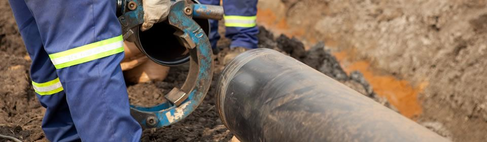 Rioolreparatie aan rioolbuis uitgevoerd.
